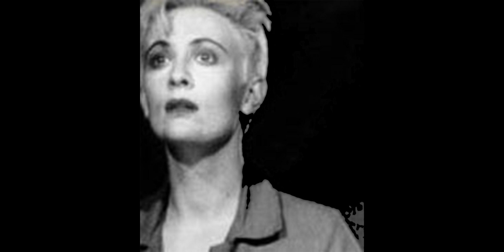 Head and shoulder shot of a woman with short hair gazing out to the distance