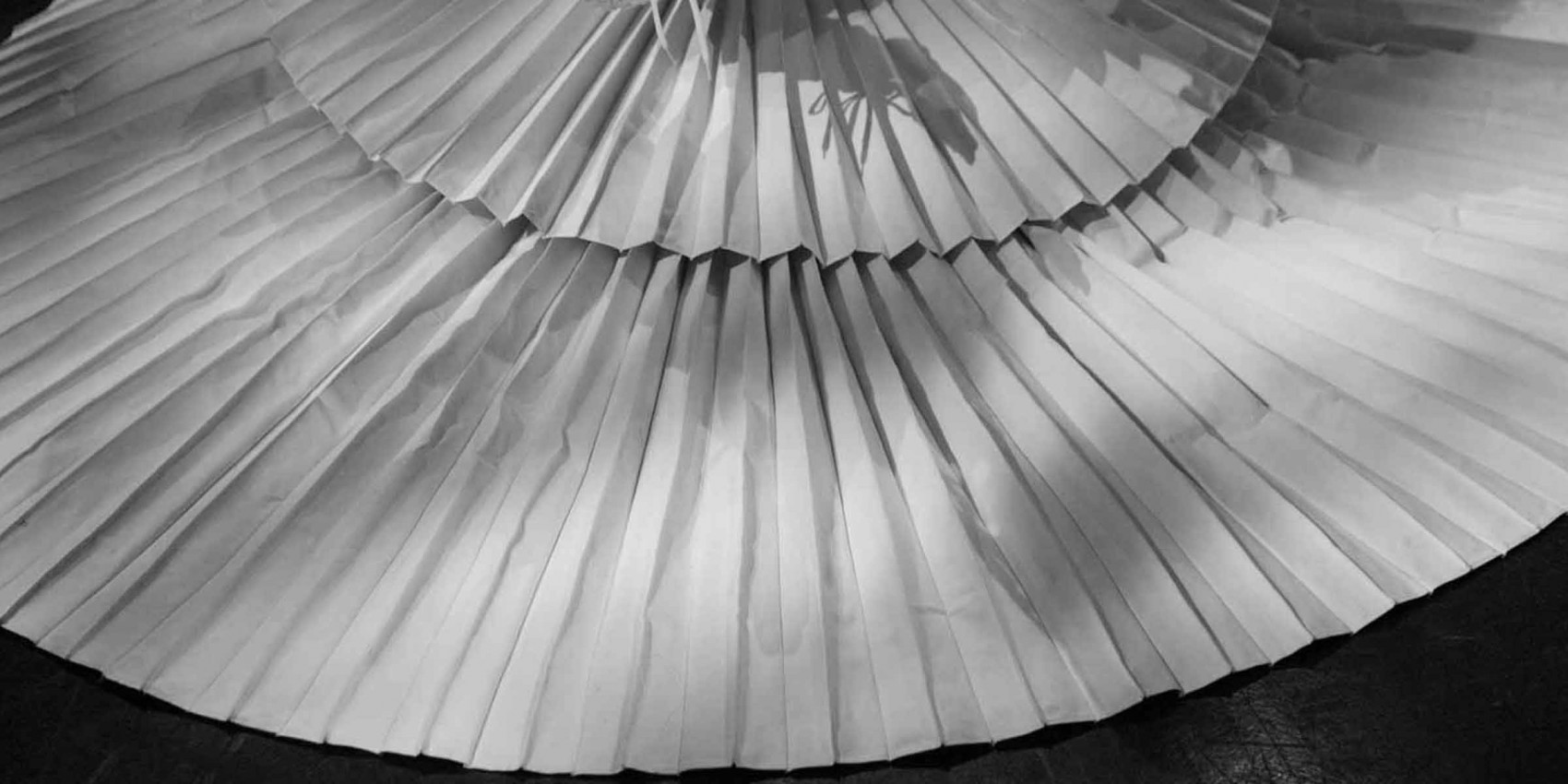 A huge circular skirt that looks to be made from concertina paper