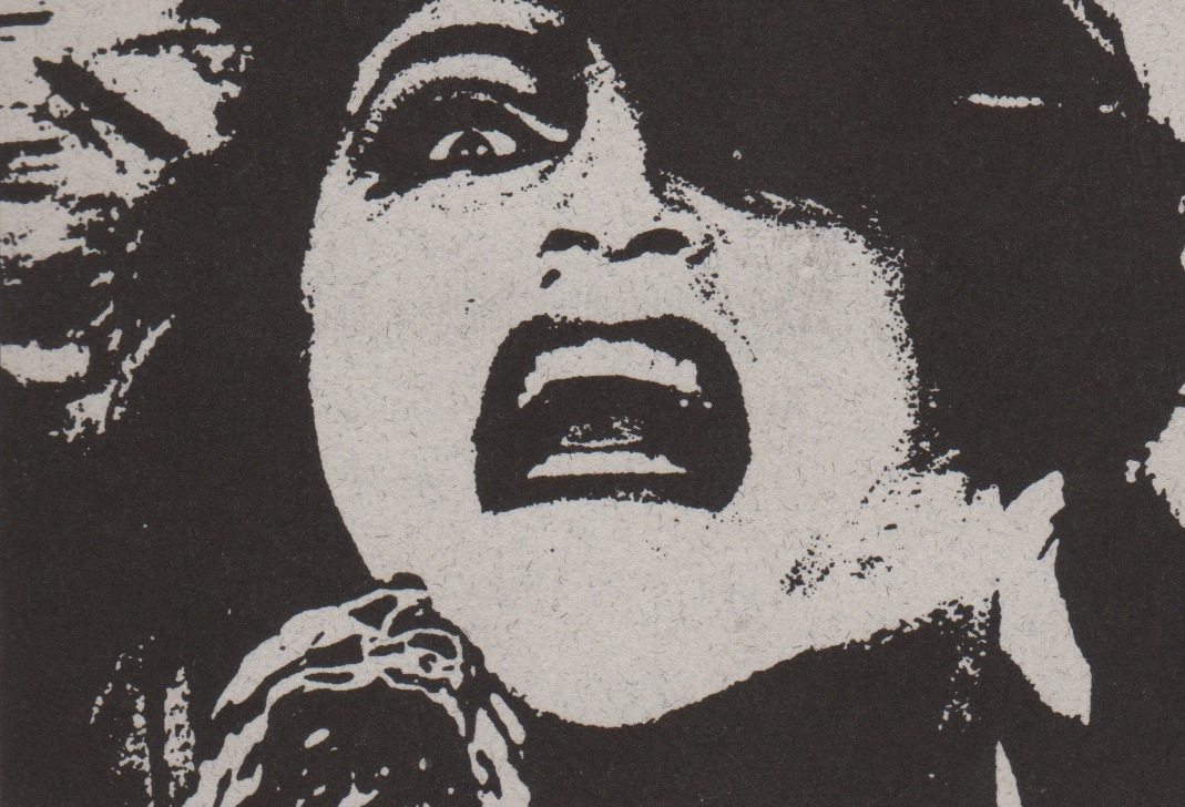 Graphic black and white image of woman's face mouth open grimacing