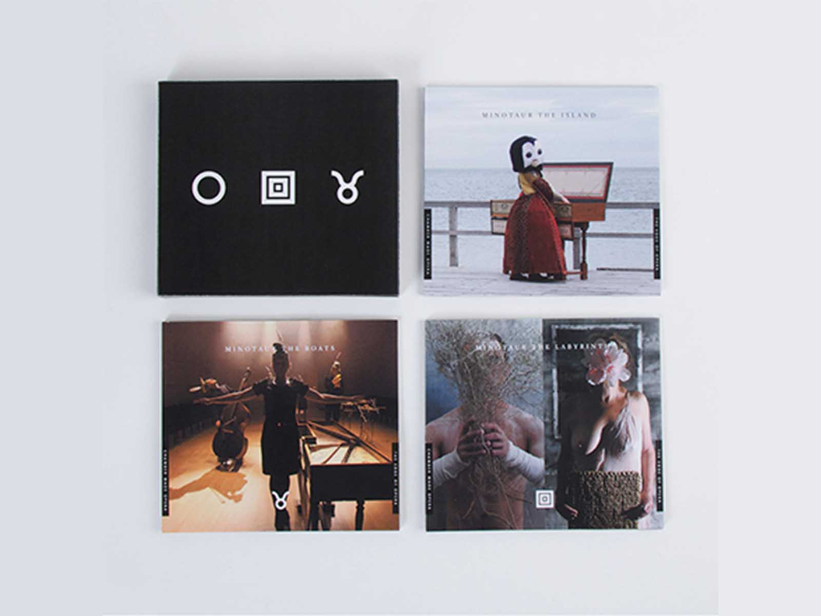 Four CD covers placed next to each other in a square shape