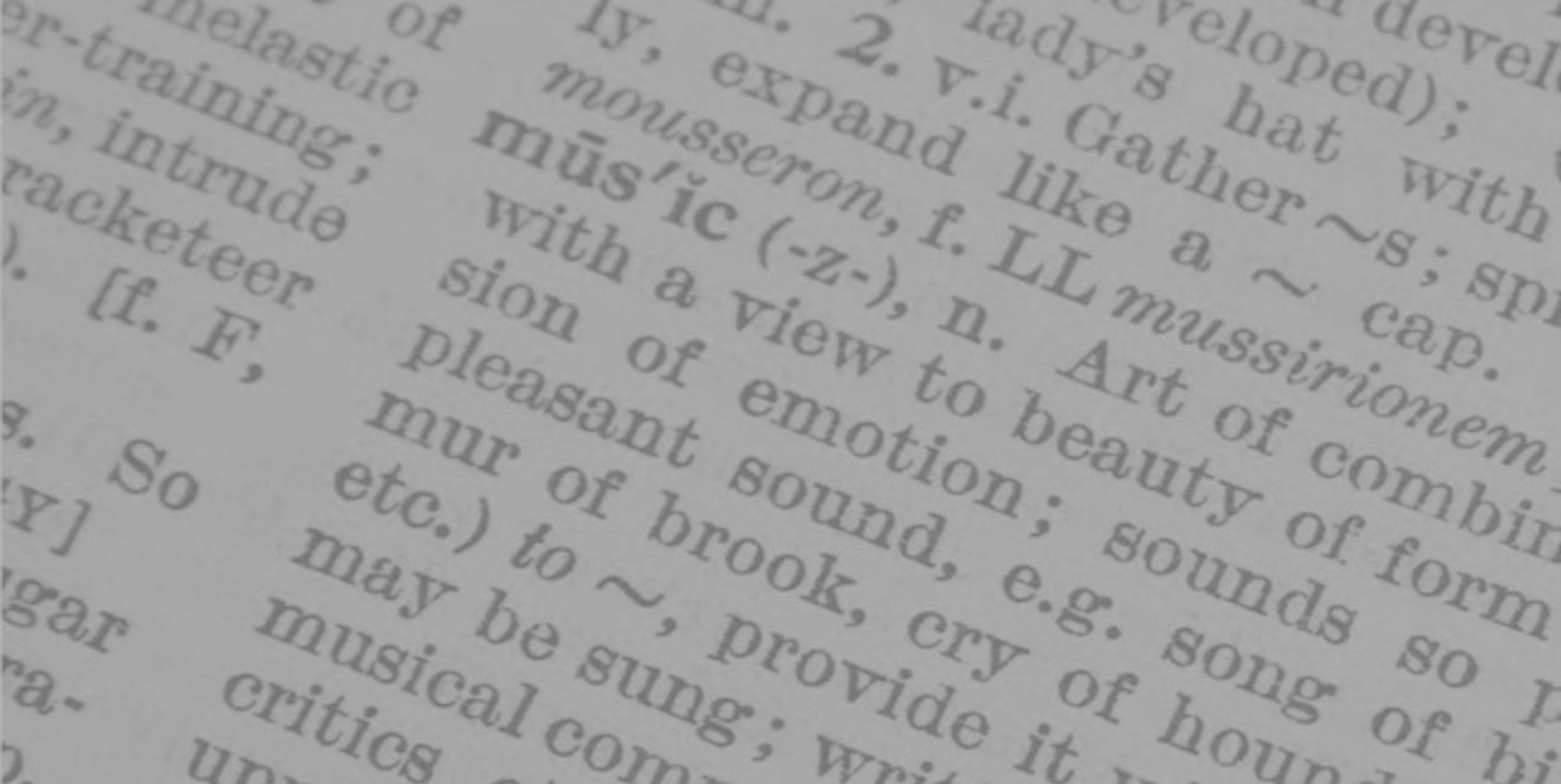 Close shot of text, definition of the word Music