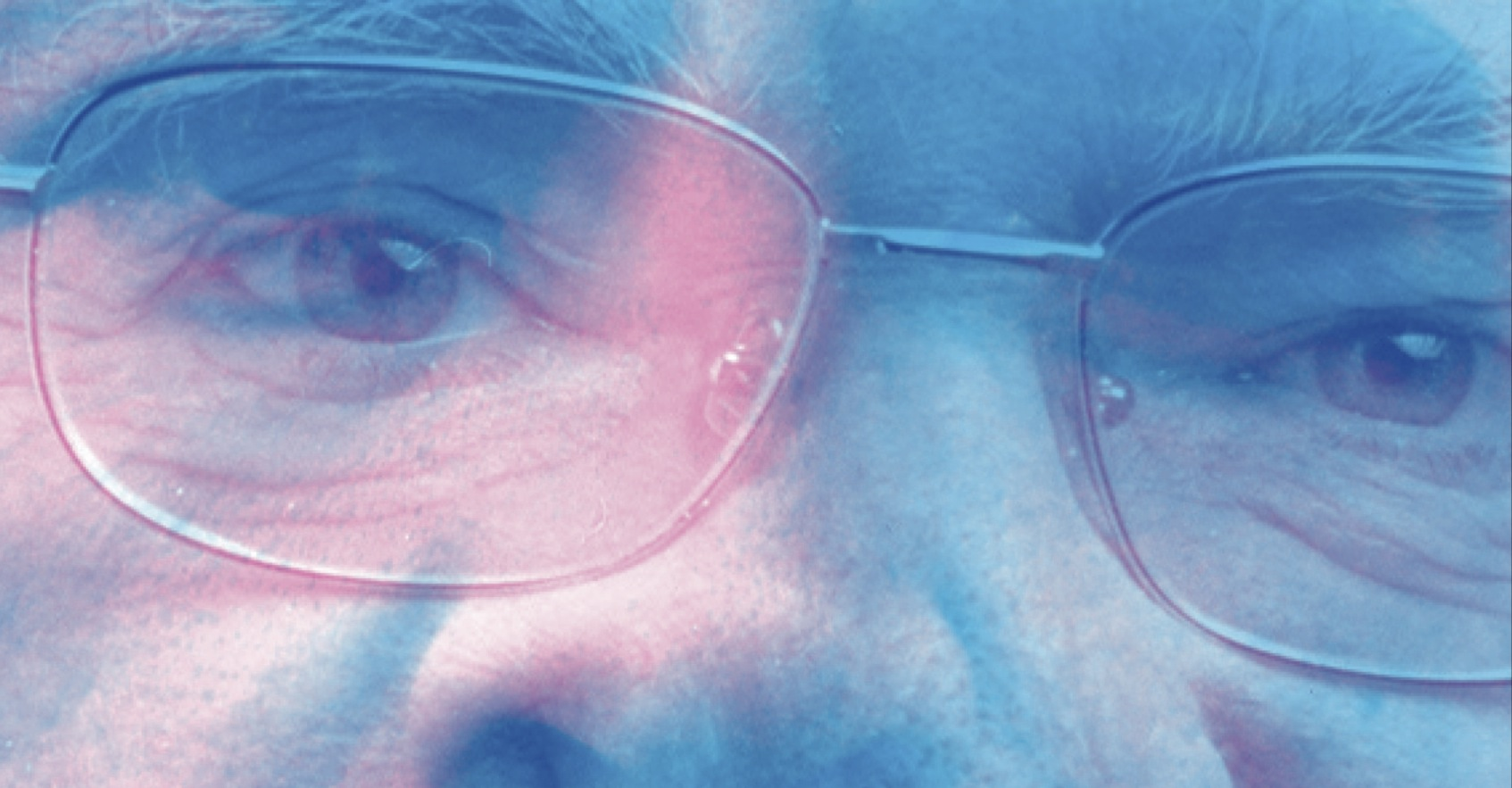 Close shot of man's eyes behind glasses