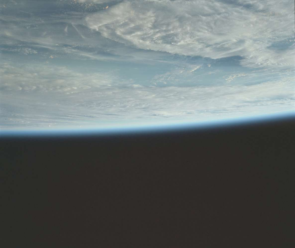 Inverted image of the earth's surface against a black background