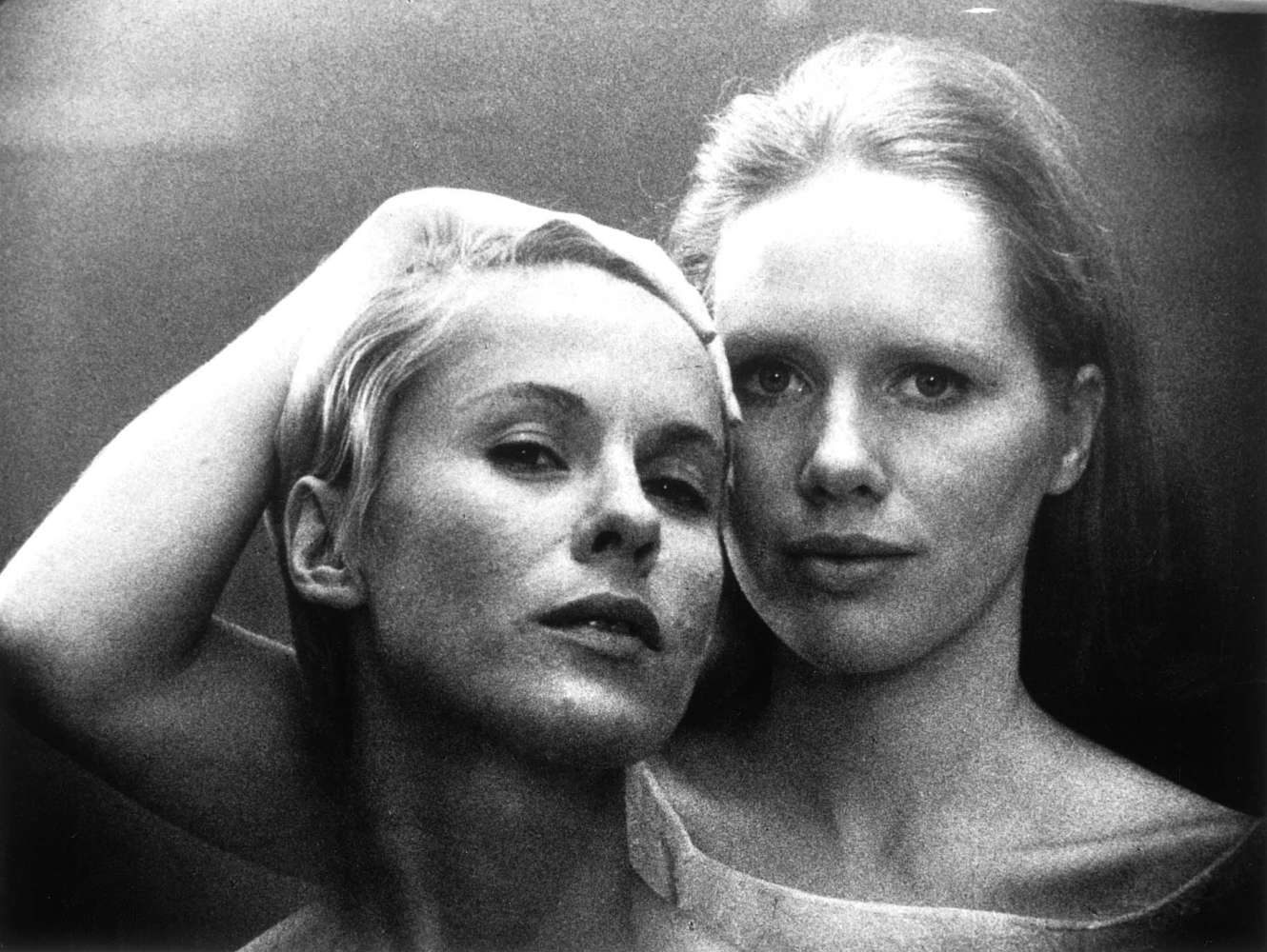 Promo shot from film Persona - head shot of two women one holding the other's hair