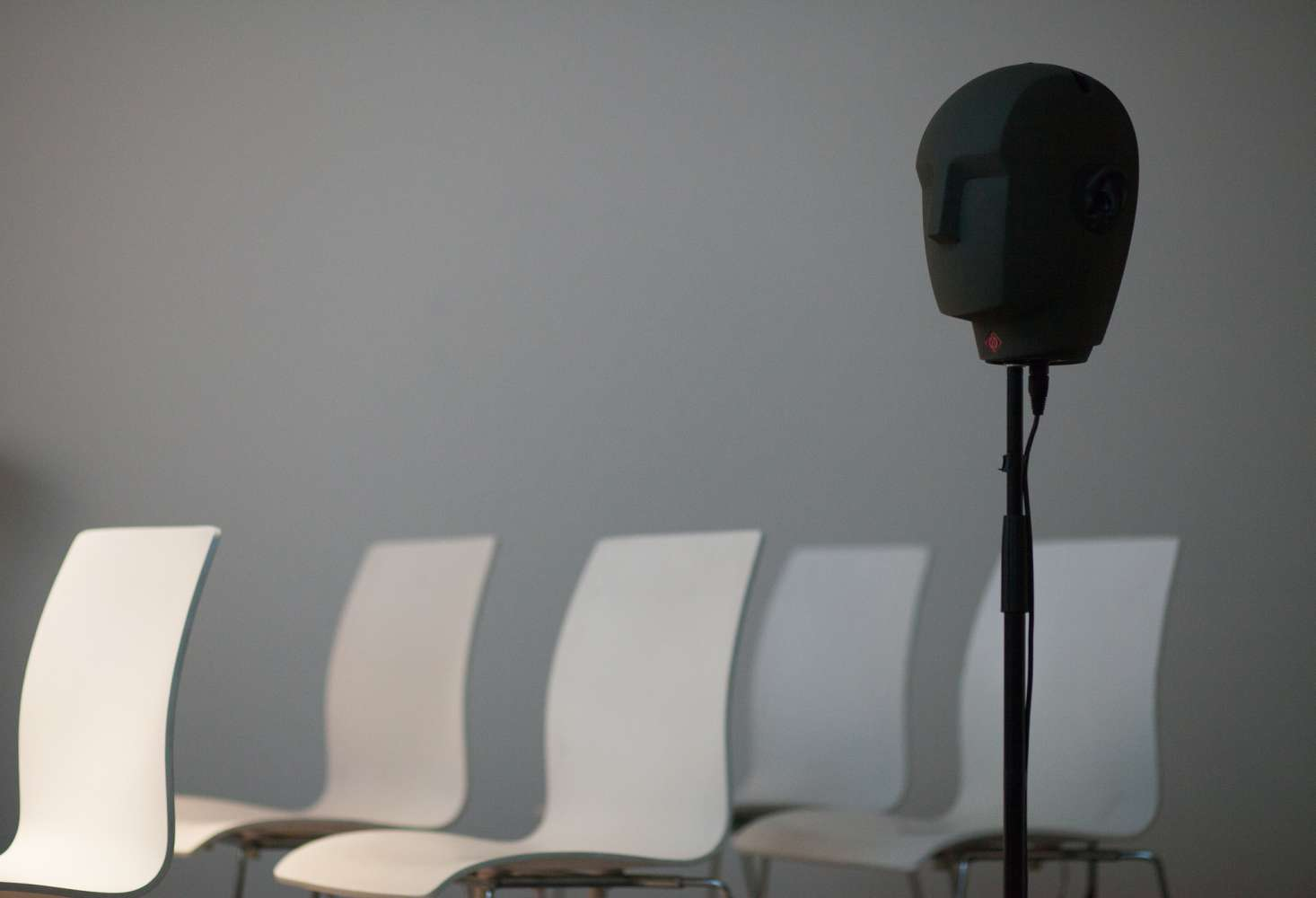Chairs and head-shaped speakers