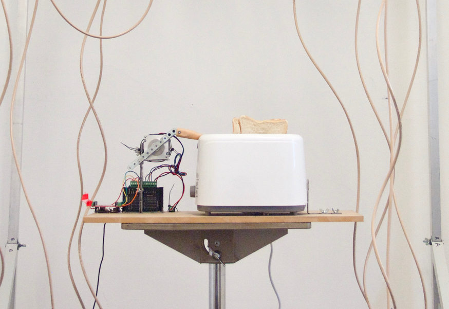 A toaster hooked up to a series of wires