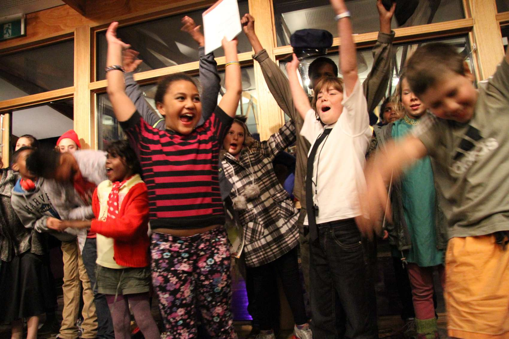 Image of children with raised arms celebrating