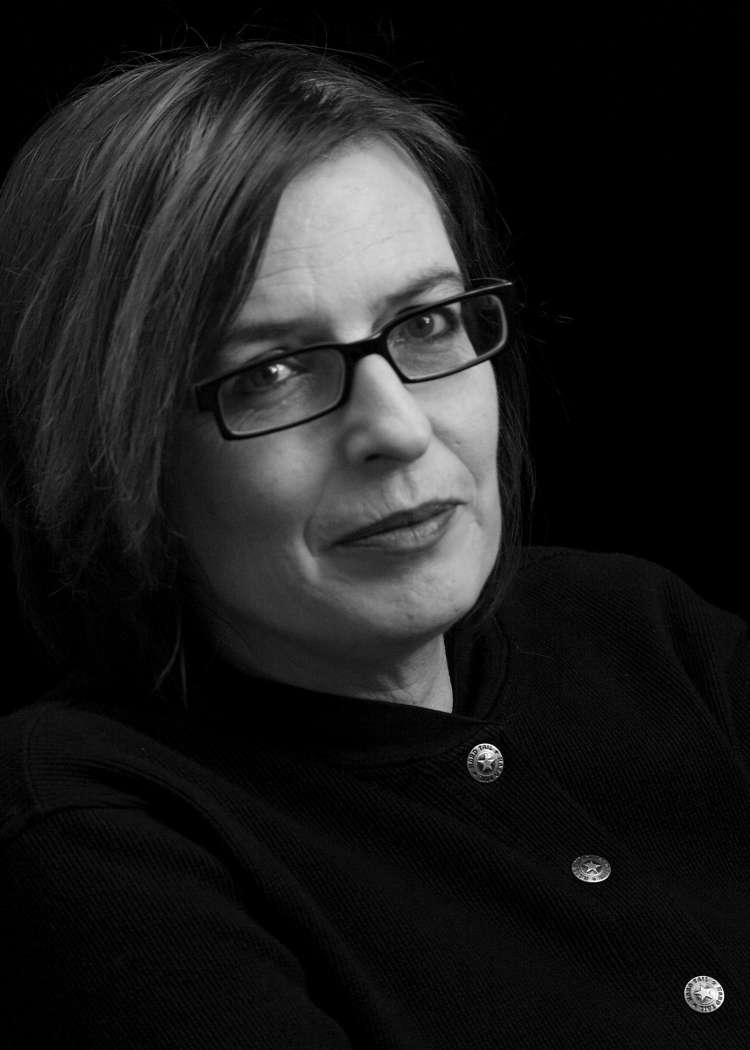 Black and white profile of woman wearing glasses